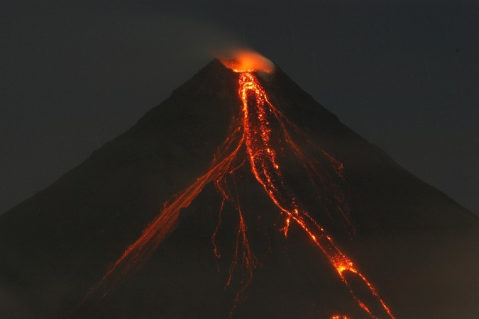 Lava cascades down the slopes of Mayon volcano in 2009