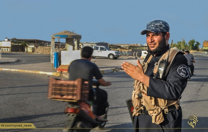 An ISIS army police mans a traffic junction in Mosul