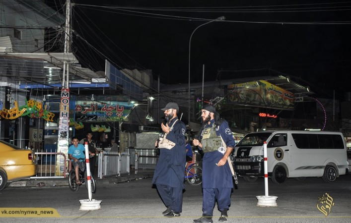 Islamic state army policemen carry out night patrol in mosul