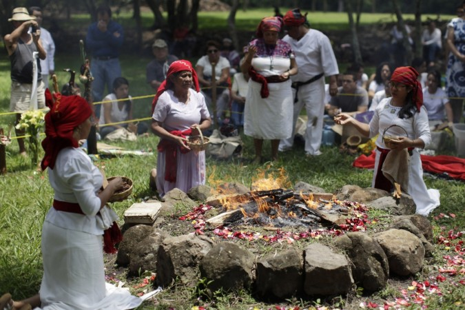 Members of the Mayan priest council pray in celebration of Autumn equinox