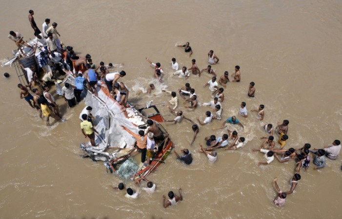 43 killed as bus falls into river