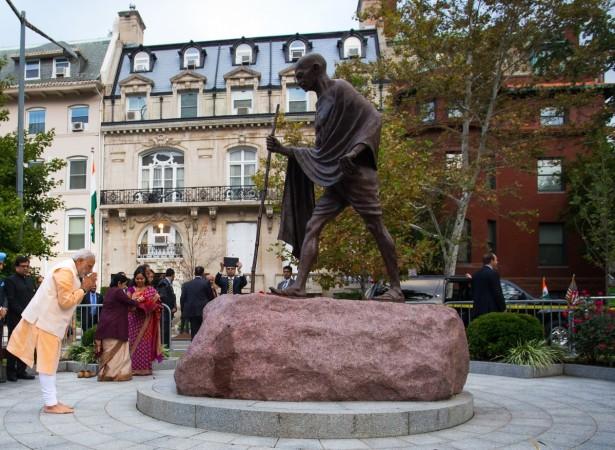 Modi bows to the statue of Mahatma Gandhi