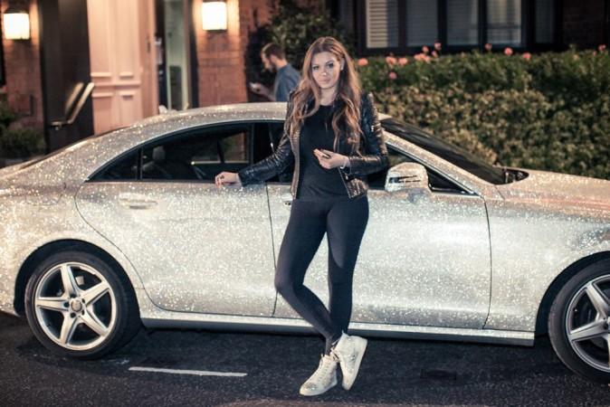 Millionaire Daria Radionova with her diamond-encrusted Mercedes