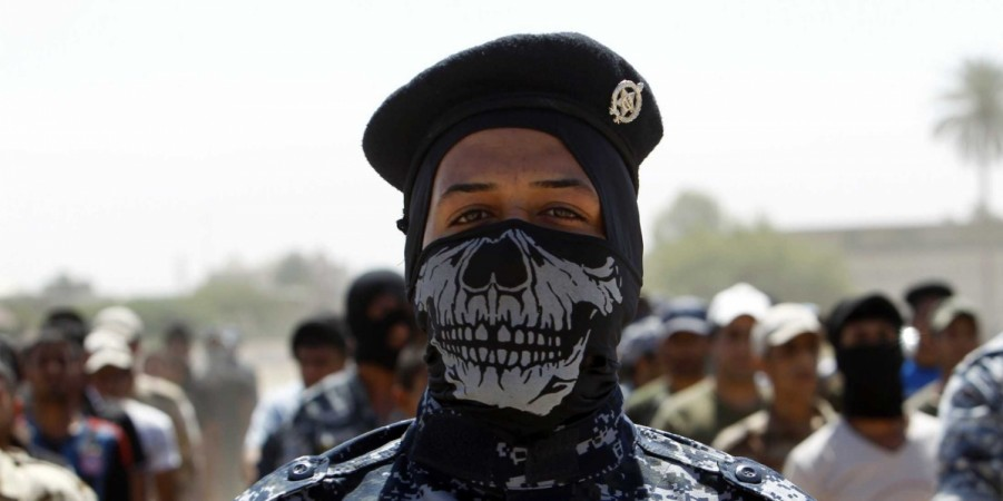 Amnesty report has found that Shia militia in Iraq has killed several Sunni Muslims to settle scores with Islamic State militants.