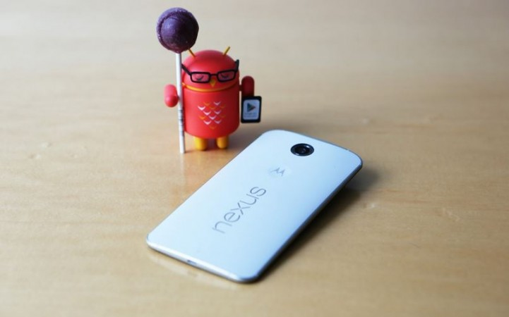Motorola Nexus 6 with Android Bot Holding Lollipop