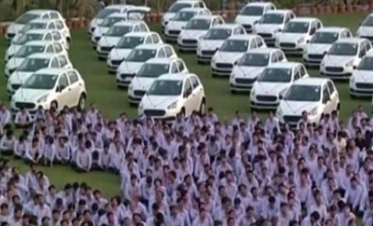 Businessman gifts cars, homes to employees as Diwali bonus