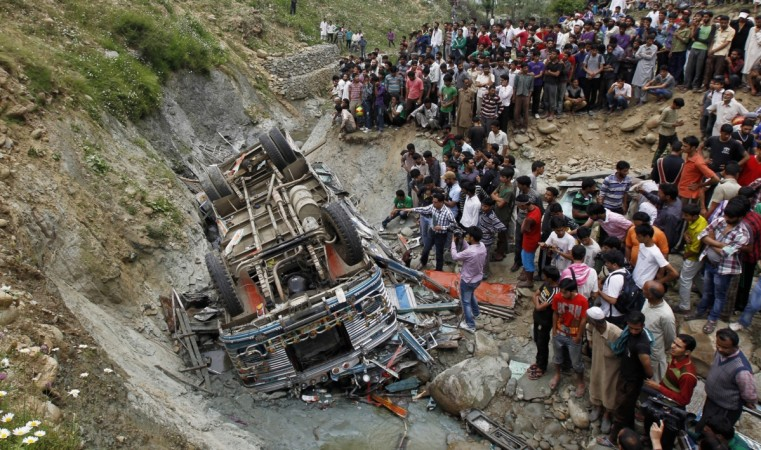At least 45 killed after horror landslide sweeps two buses off hillside