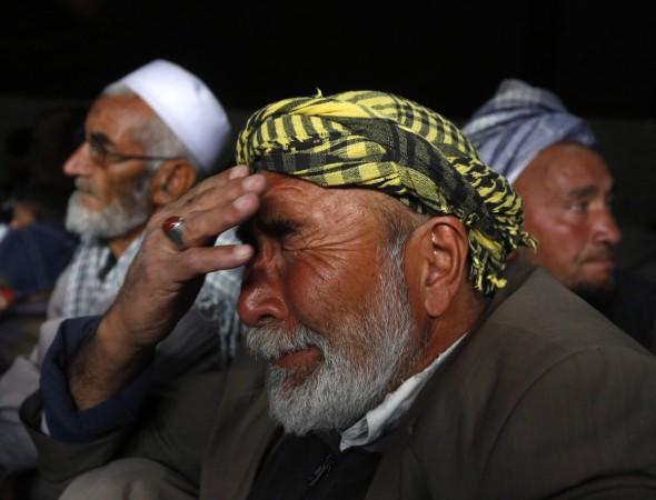 Muslim man cries as he attends a Muharram procession in Kabul