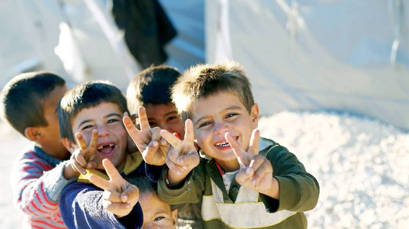 Kurdish refugee children from the Syrian town of Kobane flash victory signs in a camp in Suruc, Sanliurfa province.
