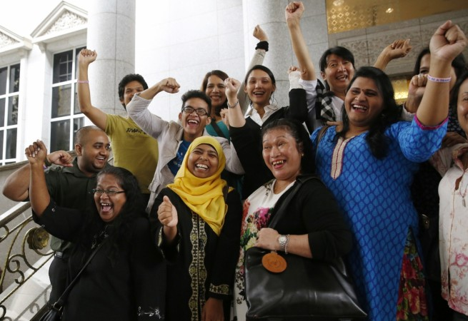 Activists celebrate overturning a sharia law against cross-dressing at the Appeals Court in the Palace of Justice in Putrajaya November 7, 2014.