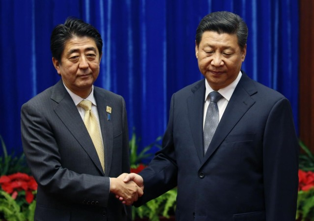 China's Xi and Japan's Abe 'Reconcilation Meet' Photo lands them on Top List of 'Awkward Handshakes'
