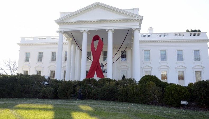 A giant red ribbon hangs from the North Portico of the White House to mark World AIDS Day, December 1, 2013,