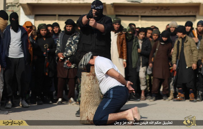 Young ISIS recruits from 'cub' camps watched in horror as the accused man was beheaded by the executioner.