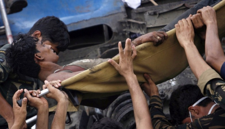 An injured passenger being moved from an overturned carriage of a train. Representative image. Reuters file