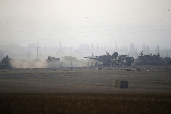 Israeli army tanks are seen outside the central Gaza Strip