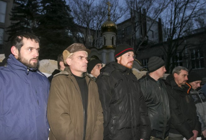 Ukrainian prisoners of war get ready to be transported for an exchange for members of pro-Russian separatists in Donetsk December 26, 2014.