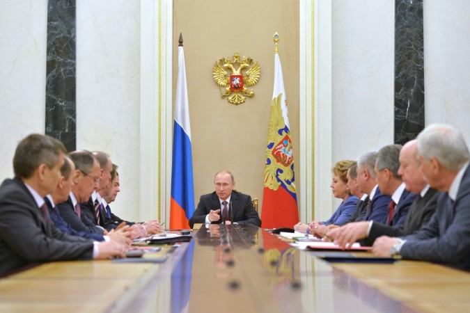 Russian President Vladimir Putin (C) chairs the Security Council in Moscow's Kremlin, December 26, 2014. Putin has signed a new military doctrine, naming NATO expansion among key external risks, the Kremlin said on Friday, days after Ukraine made fresh st