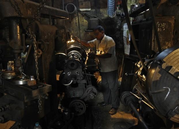 A man works inside a bridge component manufacturing unit in Kolkata