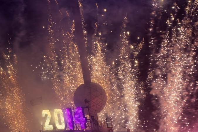 Fireworks explode past the Times Square Ball after it dropped to signal the start of the new year in Times Square, Midtown, New York January 1, 2014.