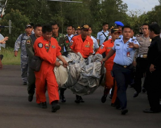 Members of the Search and Rescue Agency SARS carry debris recovered from the sea presumed from missing Indonesia AirAsia flight QZ 8501 at Pangkalan Bun, Central Kalimantan, December 30, 2014