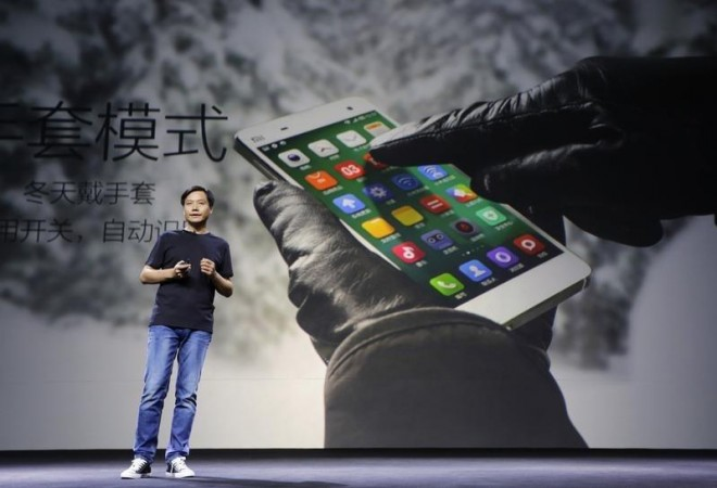 Lei Jun, founder and chief executive officer of China's mobile company Xiaomi Inc, introduces the new features of Xiaomi Phone MI 4