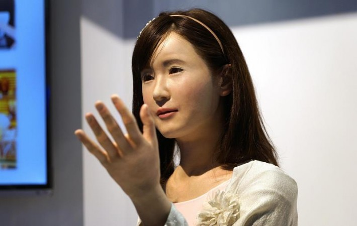 ChihiraAico, a communication android robot, gestures to show goers at the Toshiba booth at the International Consumer Electronics show