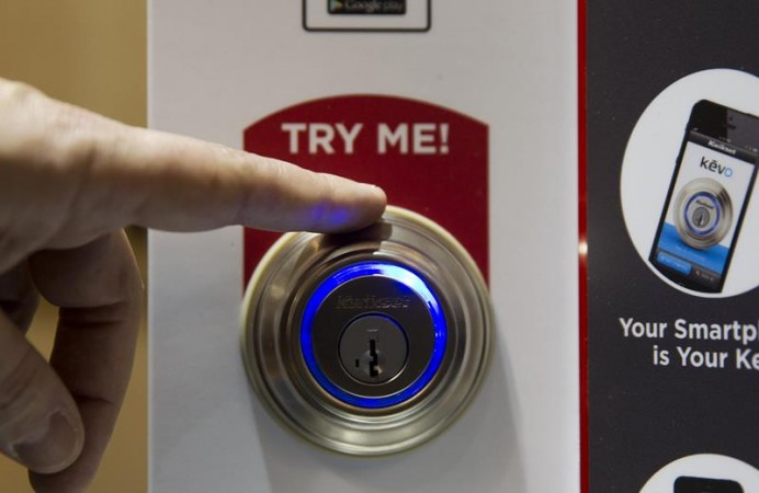 A Kevo smart lock is demonstrated during the 2015 International Consumer Electronics Show