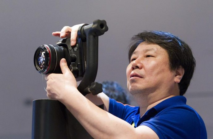 Kim Kyu-sung of South Korea holds a Canon 7D Mark II digital camera during the 2015 International Consumer Electronics Show