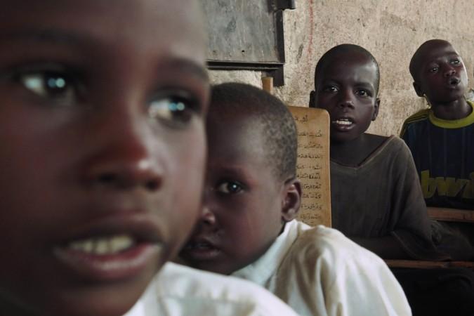 Boys recite verses from the Koran at an Almajiri Islamic school in Maiduguri May 24, 2014.