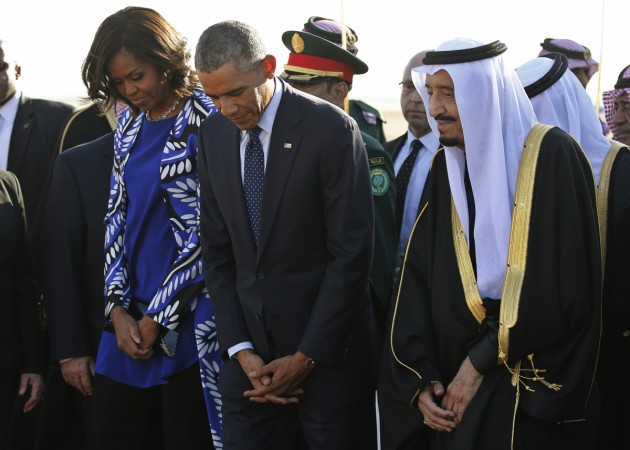 U.S. President Barack Obama and first lady Michelle Obama stand with Saudi Arabia's King Salman (R) after arriving at King Khalid International Airport in Riyadh, January 27, 2015.