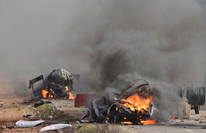 Vehicles burn Wednesday near the village of Ghajar on Israel's border with Lebanon.