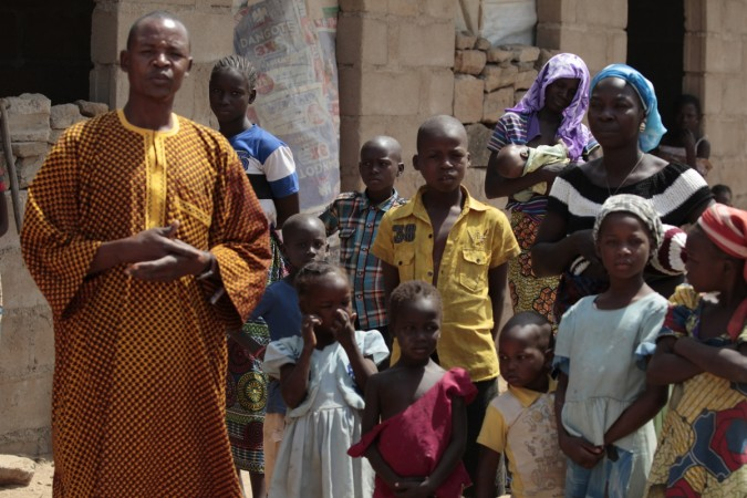 A family, that escaped Boko Haram attacks in both Michika and Cameroon, seek shelter in an uncompleted house in Adamawa January 31, 2015.