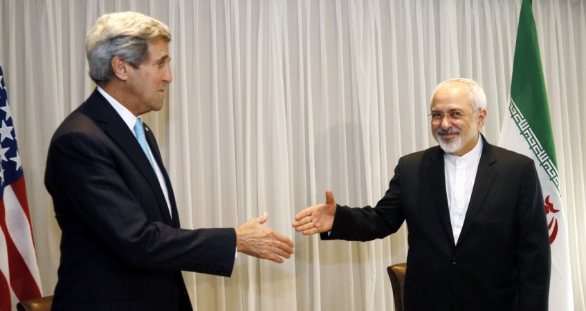 U.S. Secretary of State John Kerry shakes hands with Iranian Foreign Minister Mohammad Javad Zarif before a meeting in Geneva January 14, 2015.