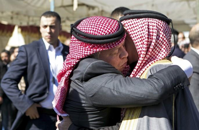 King Abdullah of Jordan consoles Safi al-Kasaesbeh, the father of Jordanian pilot Muath al-Kasaesbeh