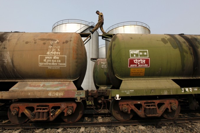 A Railway Worker inspecting tanker wagons