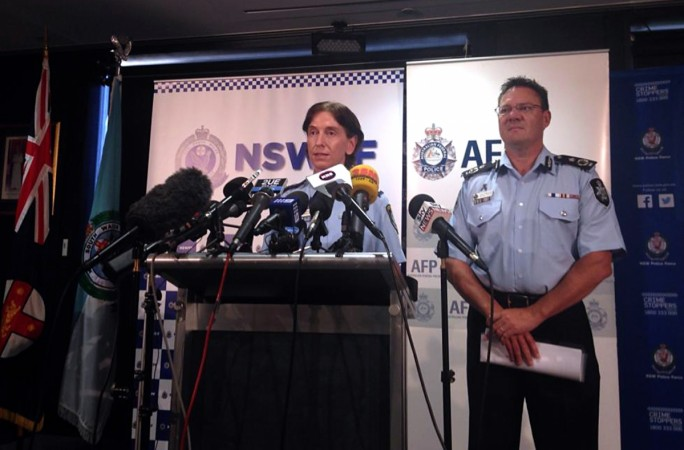 Australian Federal Police Deputy Commissioner Michael Phelan (R) listens as New South Wales Deputy Police Commissioner Catherine Burn speaks during a media conference in Sydney February 11, 2015. Australian counter-terrorism police said on Wednesday they