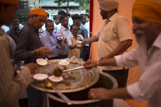 Sikh devotees distribute free food.