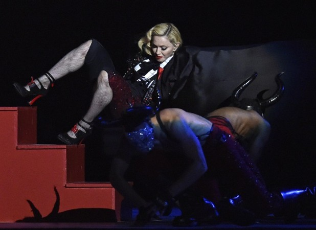 Singer Madonna falls during her performance at the BRIT music awards at the O2 Arena in Greenwich, London, February 25, 2015.