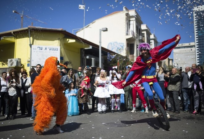 Performers wearing costumes take part in a parade ahead of the Jewish holiday of Purim outside the Bialik Rogozin school in Tel Aviv March 3, 2015.