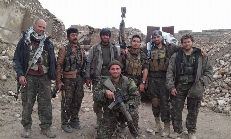 Konstandinos Erik Scurfield (kneeling) along with other foreign fighters in Syria.