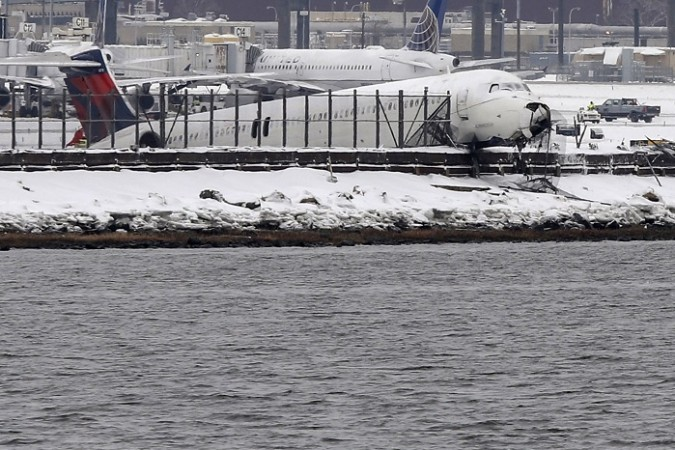 Delta flight 1086 is seen after it slid off the runway upon landing at New York's LaGuardia Airport March 5, 2015.
