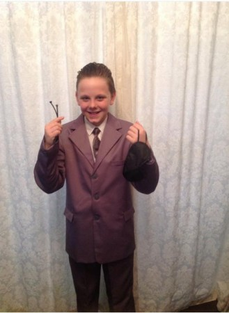 Liam Scholes went to school dressed in a grey suit with slicked black hair,dressed as Christian Grey from Fifty Shades of Grey.