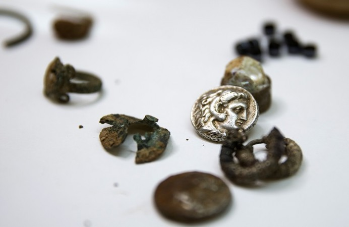 Coins and jewellery from the time of Alexander the Great are displayed in Jerusalem March 9. 2015.