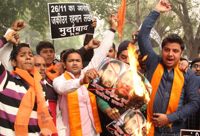Hindu Sena activists stage a demonstration to protest against the bail of Mumbai attack mastermind Zakiur Rehman Lakhvi in New Delhi, on Dec 19, 2014.