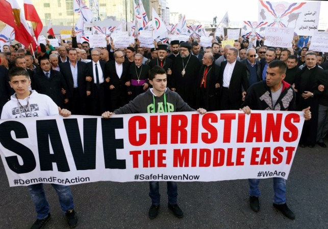 Assyrians hold banners take out a march in Beirut, Lebanon, February 28, 2015 after Isis in northeast Syria abducted Assyrian Christians