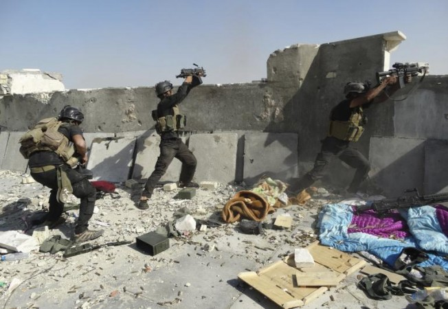 Iraqi government forces battle Isis in Ramadi