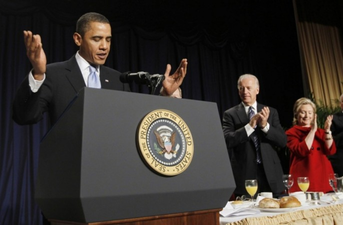 President Obama (L-R) is applauded by Vice President Biden and Secretary of State Hillary Rodham Clinton during the National Prayer Breakfast at a Washington hotel Feb. 4, 2010.