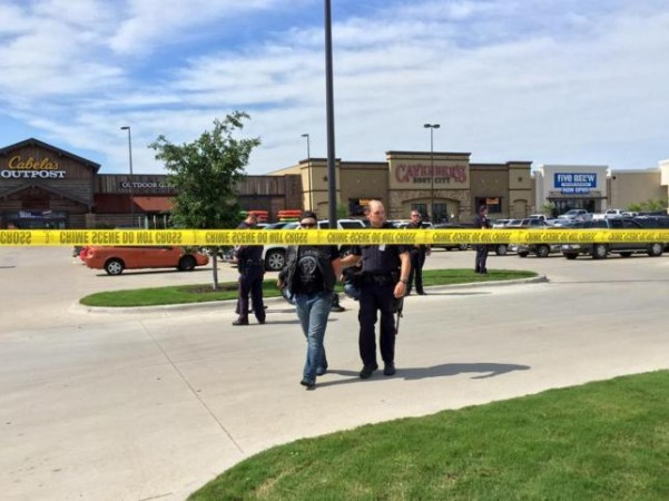 Police escort a man at the scene of a shooting in Waco, Texas, in this handout photo provided by the Waco Police Department on May 17, 2015.