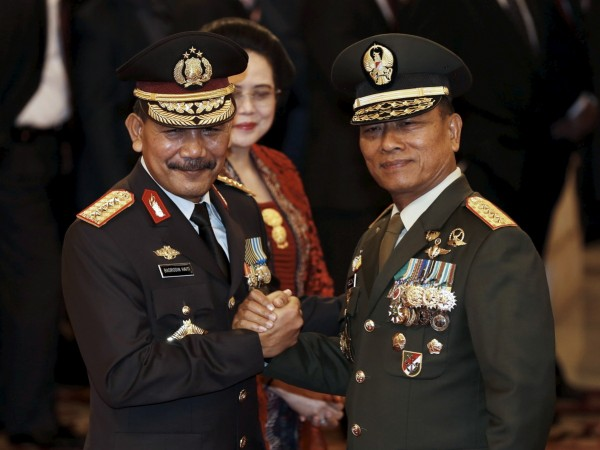 The head of Indonesia's Armed Forces General Moeldoko (right) congratulates the country's new National Police Chief Badrodin Haiti, last month. Moeldoko recently defended the Indonesian military's use of virginity tests for female recruits.