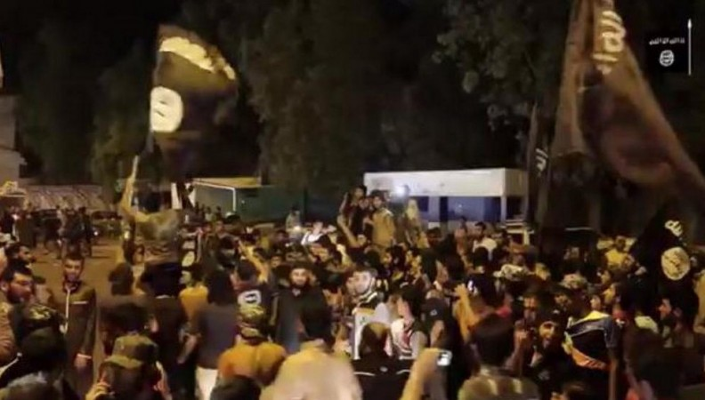 A video grab shows Isis supporters in Mosul celebrating the fall of Ramadi.